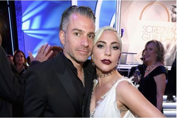 https://hips.hearstapps.com/hmg-prod.s3.amazonaws.com/images/christian-carino-and-lady-gaga-attend-the-25th-annual-news-photo-1090486050-1548682990.jpg?crop=1xw:0.66699xh;center,top&resize=480:*