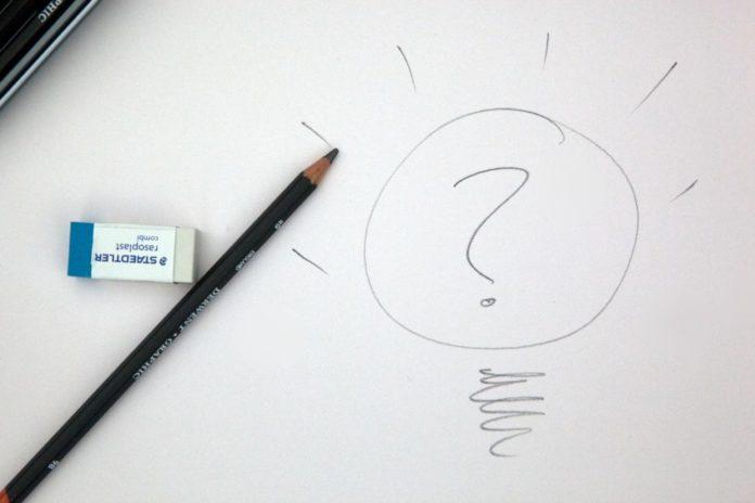drawn light bulb and a pencil
